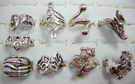 solid 925. sterling silver fashion rings in an assortment of designs picked randomly by our warehouse staff
