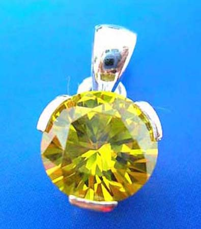 sterling silver pendant holding a shiny rounded yellow cubic zircon