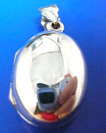plain oval shape sterling silver locket pendant, openable for holding precious treasures or pictures.