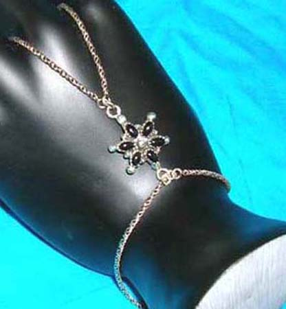 925.sterling silver slave bracelet with black fau* stone and marcasite stone design