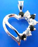 Sterling silver pendant in  heart love outline with 4 mini black and clear cz stone embedded on one side